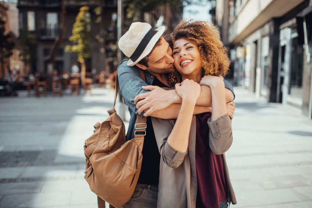 man taking care of woman travelling and leading