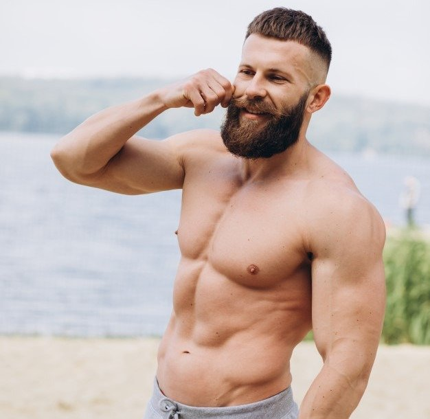 strong handsome bearded man bodybuilder